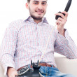 Adult young handsome man answering phone — Stock Photo