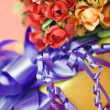 Gift with flowers. - Stock Photo