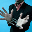 Royalty-Free Stock Photo: Business man with hands in chains