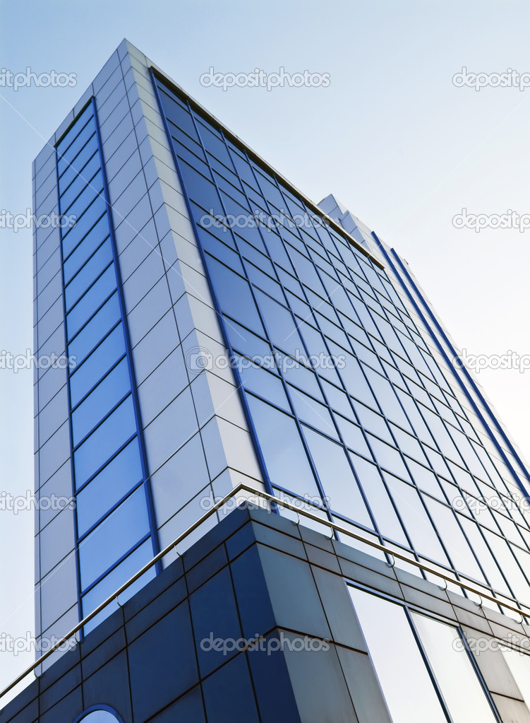 Office building on a blue stylish color of glass windows, with clear blue sky.  Stock Photo #6301709
