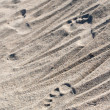 Foot steps on sand — Stock Photo