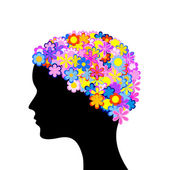 Woman head with flowers — Stock Vector