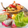 Fried fish on the dish with salad - Stock Photo