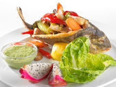 Fried fish on the dish with salad — Stock Photo
