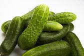 Pile of fresh cucumbers on White — Stock Photo