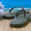 Stock Photo: Sandals and towels by pool, vacation