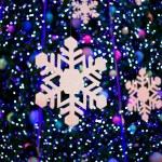 Snow on christmas light — Stock Photo