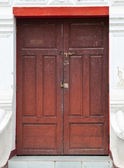 Old door on the white wall — Stock Photo