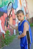 Boy playing badminton — Stock Photo