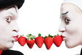 Couple of mims with the strawberry on a white background — Stock Photo