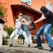 Self defence in the street — 图库照片