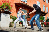Self defence in the street — Stock Photo