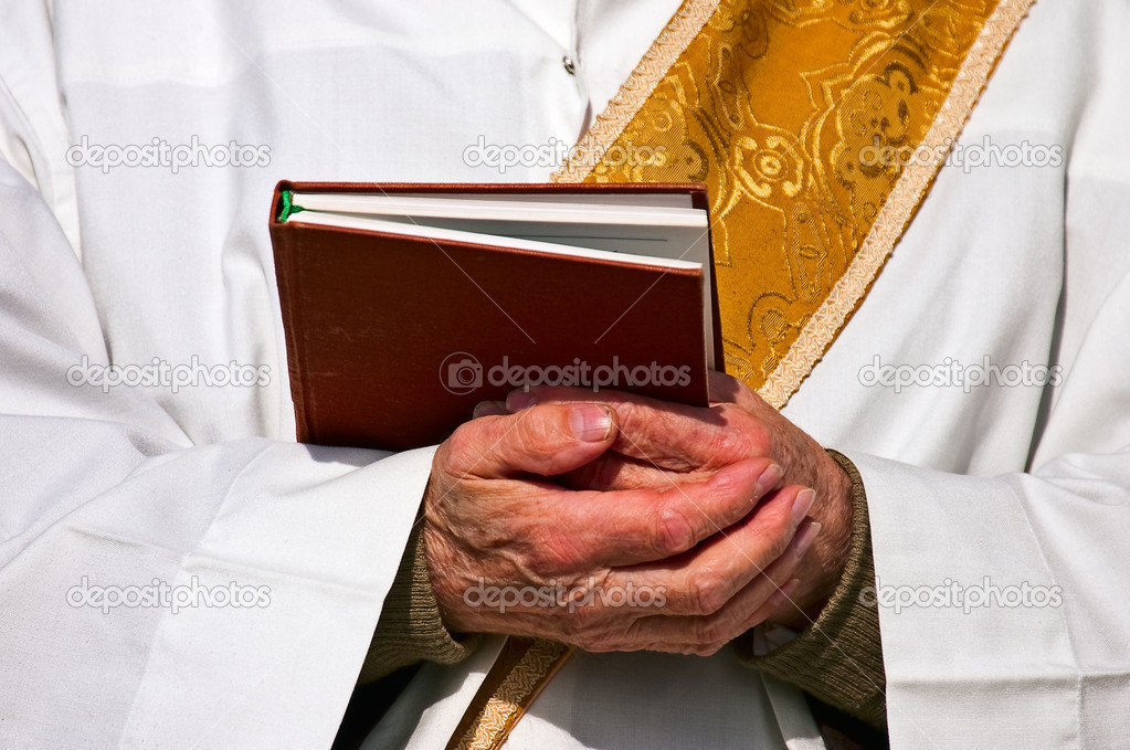 Folded hands of a priest  Stock Photo #6356820