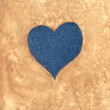 Jeans heart on aged paper — Foto Stock