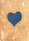 Jeans heart on aged paper — Stock Photo