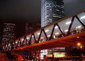Pedestrian tunnel and skyscrapers at night — Stock Photo