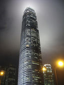 Skyscraper at night in the mist — Stock Photo