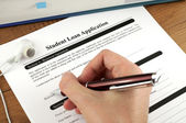 Student Loan Application Signing — Stock Photo