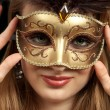 Beautiful girl with carnival mask — Stockfoto