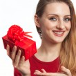 Beautiful girl holding red gift — Stock Photo #6334442