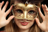 Beautiful girl with carnival mask — Stock Photo