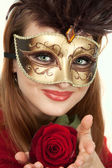 Beautiful girl with carnival mask and rose — Stock Photo