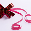Royalty-Free Stock Photo: Red satin gift bow. Ribbon