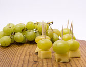 Cheese in the assortment of grapes. — Stock Photo
