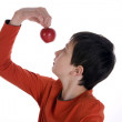 Boy looking at a red apple — Stock Photo #6492282