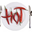 Hot chili peppers on a plate — Stock Photo