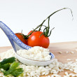 Rice and porcelain spoon — Stock Photo