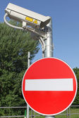 Videocamera and signpost — Stock Photo