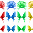Set of colored shiny decoration bows — Stock Vector