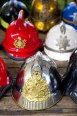 Several fireman helmets in row — Stock Photo