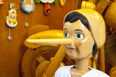 Wooden Pinocchio doll with long nose — Stock Photo