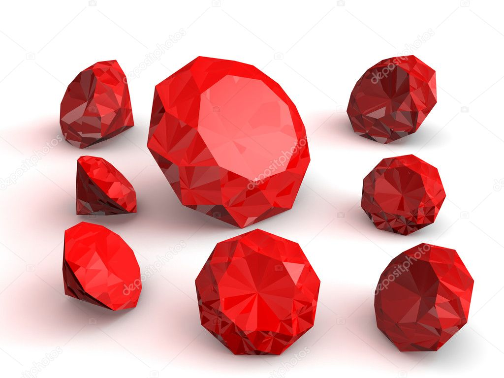 Some red brilliants (rubys) over a white background. Luxury gems — Stock Photo #6425943