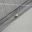 Tennis ball on the net — Stock Photo #6433657