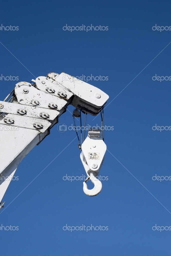 Hook of a crane in white over the sky — Stock Photo #6432951