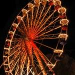 Illuminated ferris wheel at night — Stock Photo #6372623