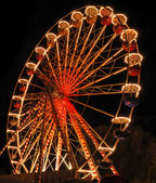 Illuminated ferris wheel at night — Stock Photo
