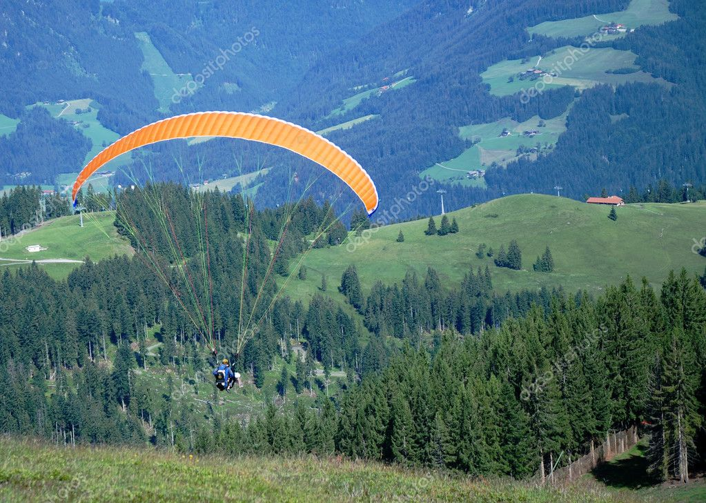 Paraglider in the austrian alps.  Stock Photo #6382133
