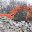 Demolition with an digger — Stockfoto