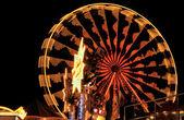 Illuminated ferris wheel at night — Stock Photo