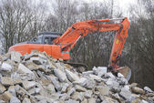 Demolition with an digger — Stock Photo