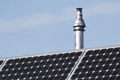 Chimney and photovoltaic cells — Stock Photo