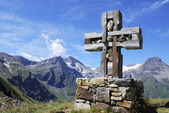 Cross in the alps — Stock Photo