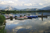 Alpine lake with boats — Fotografia Stock