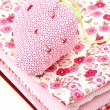 Pincushion on a Pile of Textile — Stock Photo