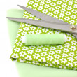Sewing Items on Floral Cloth — Stock Photo