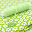Sewing Items on Floral Cloth - Stock Photo